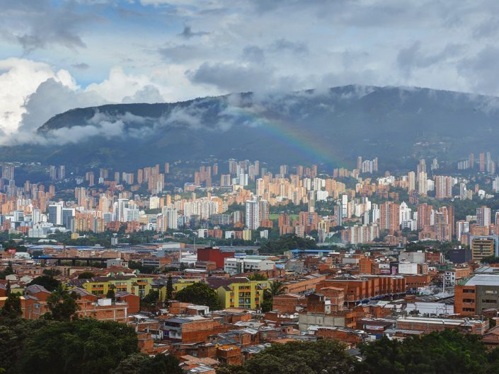 Picture of Medellin Colombia with a rainbow
