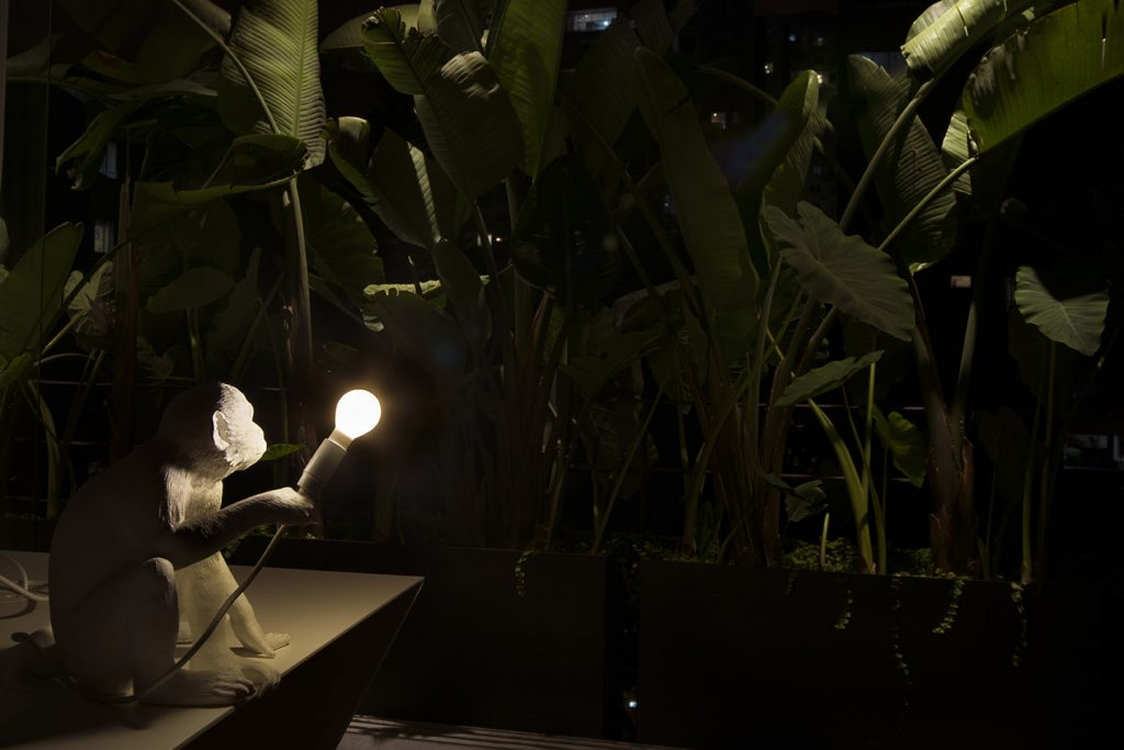 White Ceramic Monkey Lamp with Dramatic Lighting